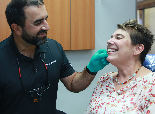 Dentist examining dental patient