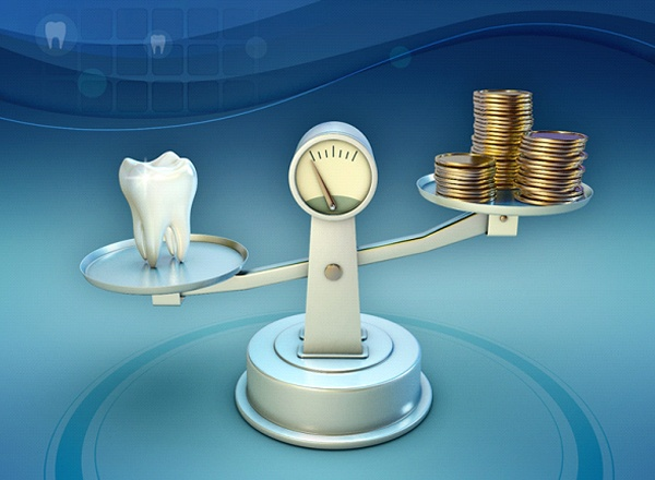 A scale holding a tooth on one end and money on the other
