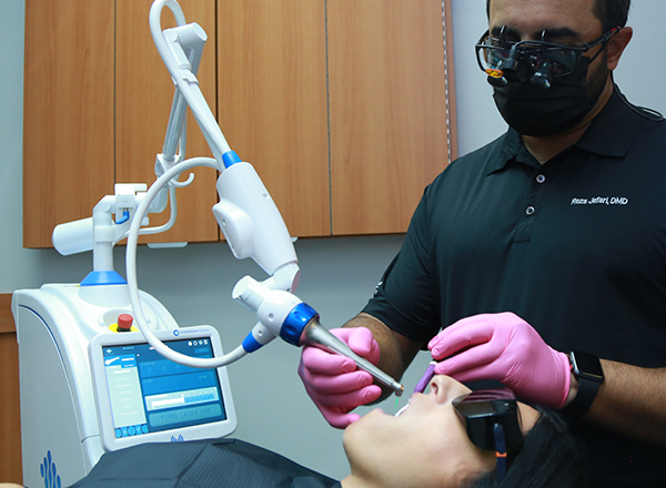 Dentist using Solea laser system